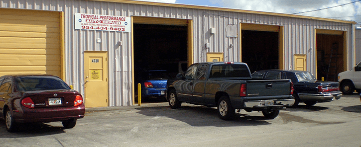 Cars at a High-Performance Auto Body Shop