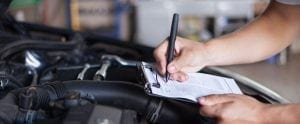 a technician working on engine diagnostics