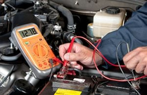 mechanic working on Automotive Electrical Repair