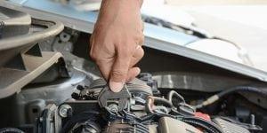 a mechanic repairing a battery