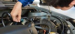 a mechanic repairing a car in hillsboro beach