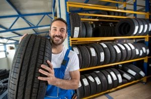 a mechanic grabbing a tire
