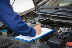 mechanic performing vehicle inspection in coconut creek