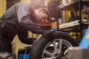mechanic working on brakes and tires in coconut creek